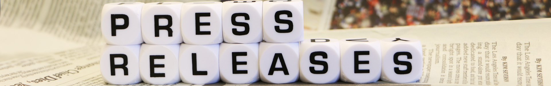 dices with words of Press Release on them