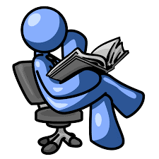 a person is sitting on a chair and reading