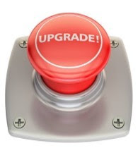 a round red button with word of Upgrade on top