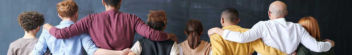 People with different skin color and hair color holding shoulders together