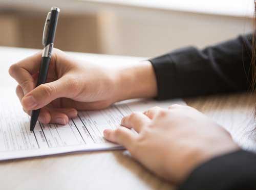 hand holding a pen